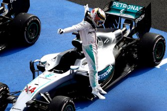 Lewis Hamilton, Mercedes F1 W07 Hybrid, 1st Position, celebrates as he jumps from his car in Parc Ferme