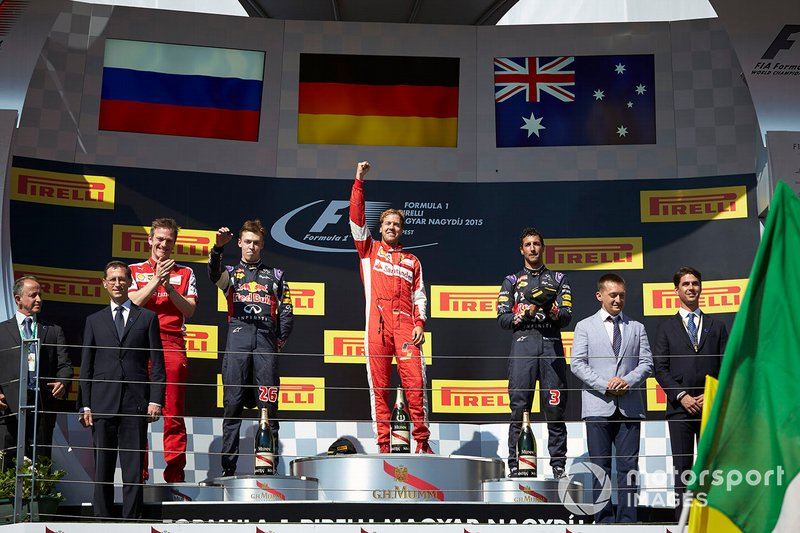 Podium: race winner Sebastian Vettel, Ferrari, second place Daniil Kvyat, Red Bull Racing, third place Daniel Ricciardo, Red Bull Racing