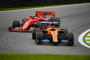 Carlos Sainz Jr., McLaren MCL34 and Sebastian Vettel, Ferrari SF90