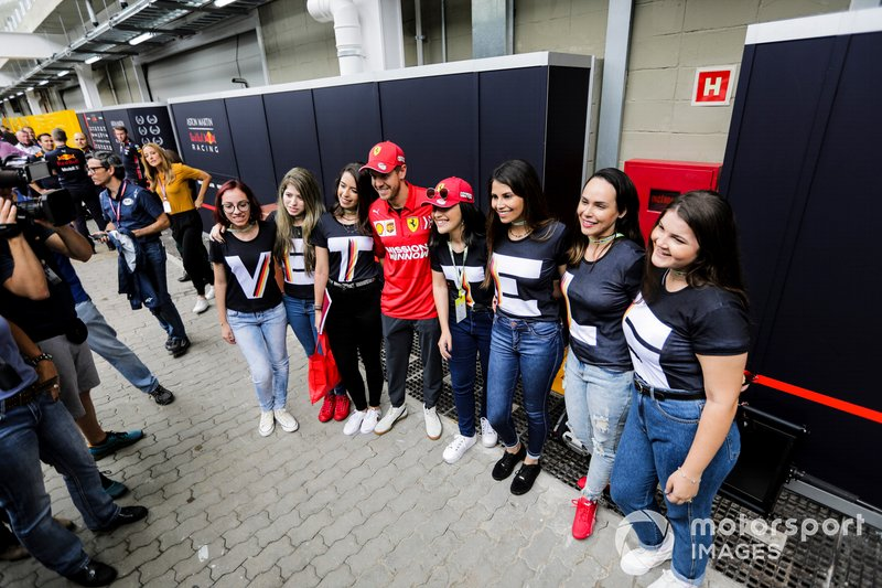 Sebastian Vettel, Ferrari with fans in the paddock