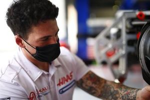 A mechanic at work in the Haas F1 garage