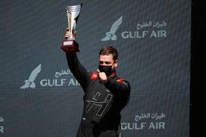 The Hitech Grand Prix team representative on the podium