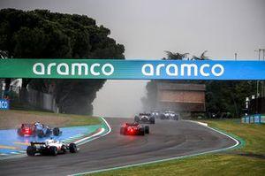 Fernando Alonso, Alpine A521, Sebastian Vettel, Aston Martin AMR21, Nicholas Latifi, Williams FW43B, and Nikita Mazepin, Haas VF-21