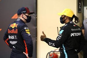 Max Verstappen, Red Bull Racing, and Lewis Hamilton, Mercedes-AMG F1, in Parc Ferme