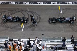 Lewis Hamilton, Mercedes-AMG F1, 3rd position, and Valtteri Bottas, Mercedes-AMG F1, 2nd position, congratulate each other on the grid after performing donuts
