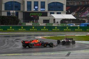 Kimi Raikkonen, Alfa Romeo Racing C39, passes as Max Verstappen, Red Bull Racing RB16, spins