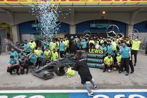 Lewis Hamilton, Mercedes-AMG F1, celebrates with his team by and Valtteri Bottas, Mercedes-AMG F1 after winning his 7th championship, by spraying champagne
