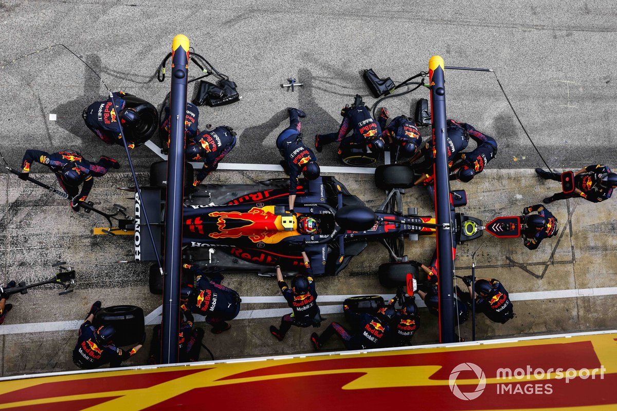 Sergio Perez, Red Bull Racing RB16B, makes a pit stop