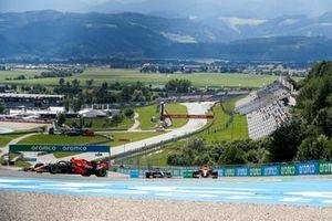 Sergio Perez, Red Bull Racing RB16B, Daniel Ricciardo, McLaren MCL35M, and Sebastian Vettel, Aston Martin AMR21
