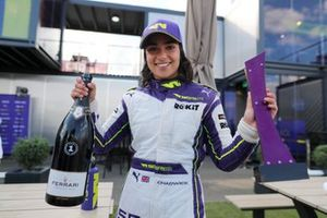 Jamie Chadwick, 1st position, with her trophy and Champagne