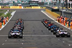 Max Verstappen, Red Bull Racing RB16B, and Lewis Hamilton, Mercedes W12, lead the field away as the lights go green