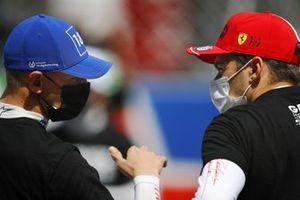Mick Schumacher, Haas F1, with Charles Leclerc, Ferrari