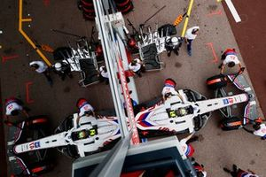 Mick Schumacher, Haas VF-21, is returned to the garage