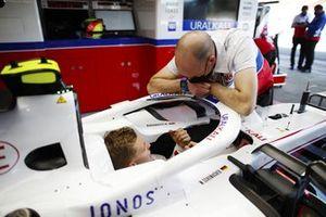 Mick Schumacher, Haas F1, in cockpit, talks to a colleague