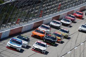A.J. Allmendinger, Kaulig Racing, Chevrolet Camaro Hyperice and Austin Cindric, Team Penske, Ford Mustang Car Shop