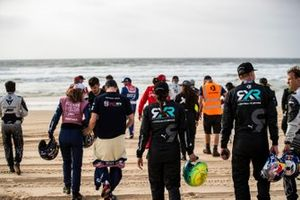 The drivers gather on the beach for a photoshoot