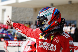 Kimi Raikkonen, Ferrari, gives a thumbs up as he celebrates after winning the race