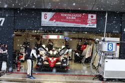 Stephane Sarrazin, Mike Conway, Kamui Kobayashi, #06 Toyota Gazoo Racing Toyota TS050 Hybrid during a snow shower in the pits