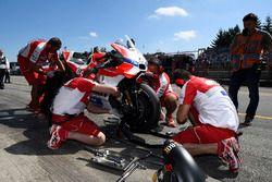 Mechanics work on the bike of Andrea Dovizioso, Ducati Team