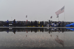 Cars lined up in the rain and fog for tech inspection