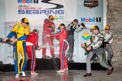 GTD Podium: 1. Christina Nielsen, Alessandro Balzan, Jeff Segal, Scuderia Corsa; 2. Bret Curtis, Jen