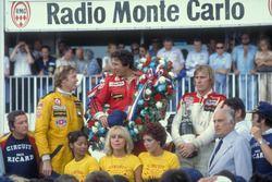 Podium: winner Mario Andretti, Team Lotus Ford, second place Ronnie Peterson, Team Lotus Ford, third