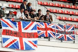 Fans of Lewis Hamilton, Mercedes AMG F1 W08, display banners of support