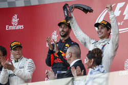 Lance Stroll, Williams celebrates on the podium, the trophy alongside race winner Daniel Ricciardo, Red Bull Racing and Valtteri Bottas, Mercedes AMG F1