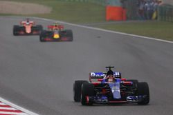 Daniil Kvyat, Scuderia Toro Rosso STR12, leads Max Verstappen, Red Bull Racing RB13, and Fernando Al