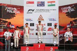 Podium: race winner Jordan Love, second place Danial Nielsen Frost, third place Akash Gowda