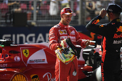 Pole sitter Sebastian Vettel, Ferrari and Daniel Ricciardo, Red Bull Racing in parc ferme