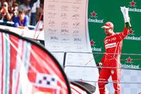 Third place Sebastian Vettel, Ferrari on the podium
