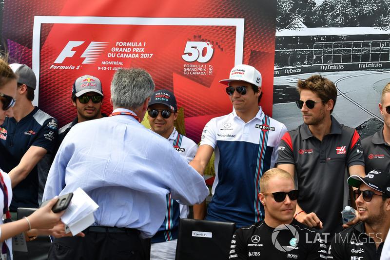 Председатель Formula One Group Чейз Кэри и гонщик Williams Лэнс Стролл