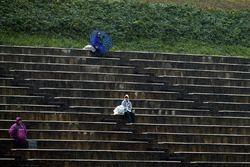 Fans in de regen