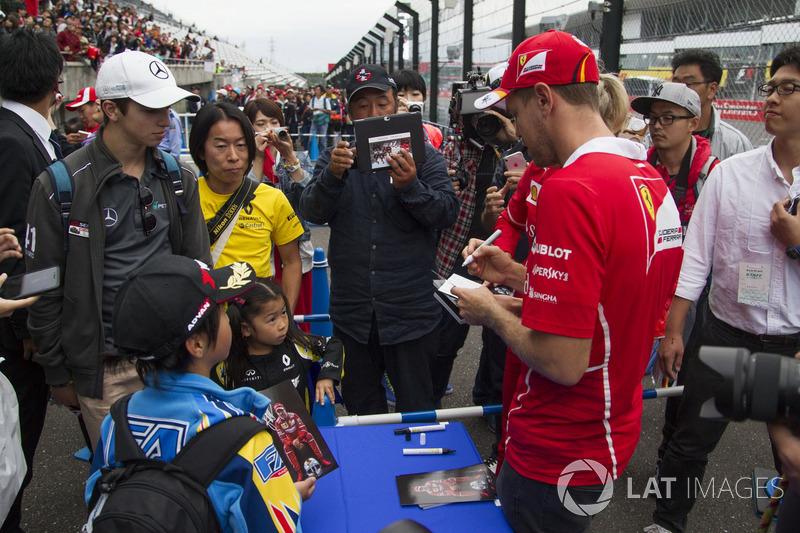 Sebastian Vettel, Ferrari, signs autographs for the fans