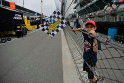 Young fan with checkered flag, atmosphere