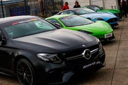 A Mercedes, McLaren and Aston Martin line-up ahead of participating in Pirelli Hot Laps
