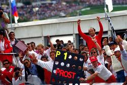 The McLaren team, including a delighted Jo Ramirez, celebrate victory for Alain Prost, McLaren