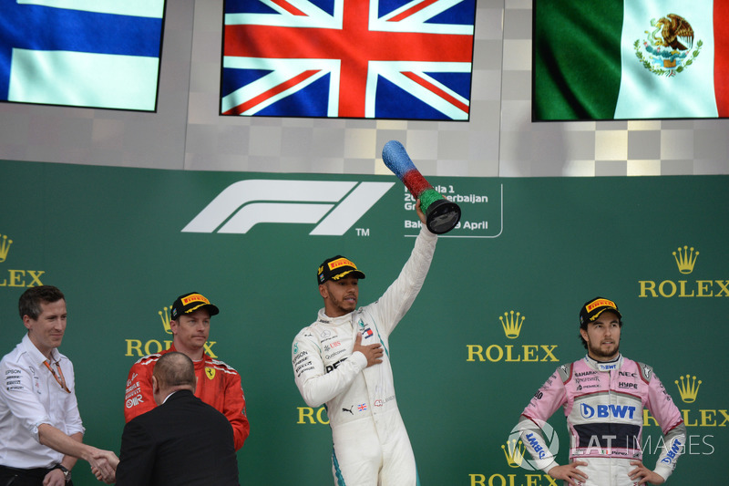 Podio 2018: Kimi Raikkonen, Ferrari, Lewis Hamilton, Mercedes-AMG F1 y Sergio Perez, Force India