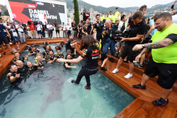 Red Bull Racing celebrate in the Red Bull Energy Station swimming pool