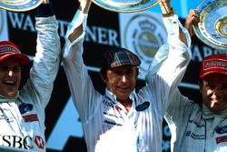L to R Winner Johnny Herbert, Team Boss Jackie Stewart and third placed Rubens Barrichello