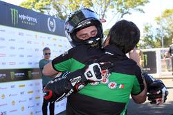 Michael Dunlop celebrates winning his third TT of the week in the Lightweight race