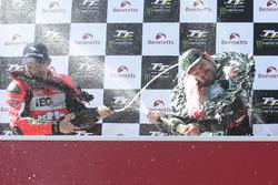 Michael Dunlop celebrates winning his third TT of the week in the Lightweight race with runner up Derek McGee