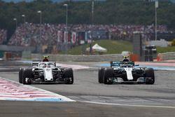 Valtteri Bottas, Mercedes AMG F1 W09, passes Charles Leclerc, Sauber C37