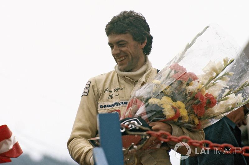 Tom Pryce, UOP Shadow Racing Team celebrates third place on the podium