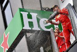 Race winner Sebastian Vettel, Ferrari celebrates with the champagne on the podium