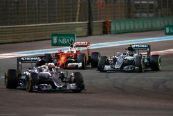 Sebastian Vettel, Ferrari SF16-H, battles with Nico Rosberg, Mercedes F1 W07 Hybrid, as Lewis Hamilt