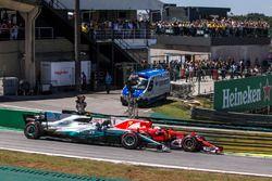 Sebastian Vettel, Ferrari SF70H and Valtteri Bottas, Mercedes-Benz F1 W08 battle for the lead at th