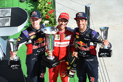Daniil Kvyat, Red Bull Racing, race winner Sebastian Vettel, Ferrari and Daniel Ricciardo, Red Bull Racing celebrate on the podium