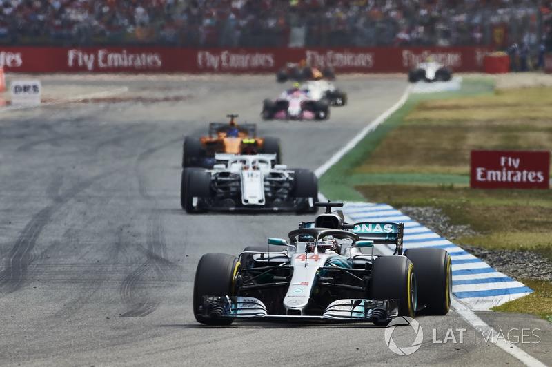 Lewis Hamilton, Mercedes AMG F1 W09, leads Charles Leclerc, Sauber C37